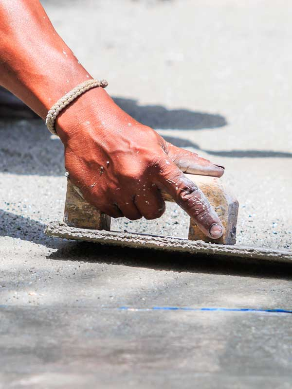 Construction workers laying cement